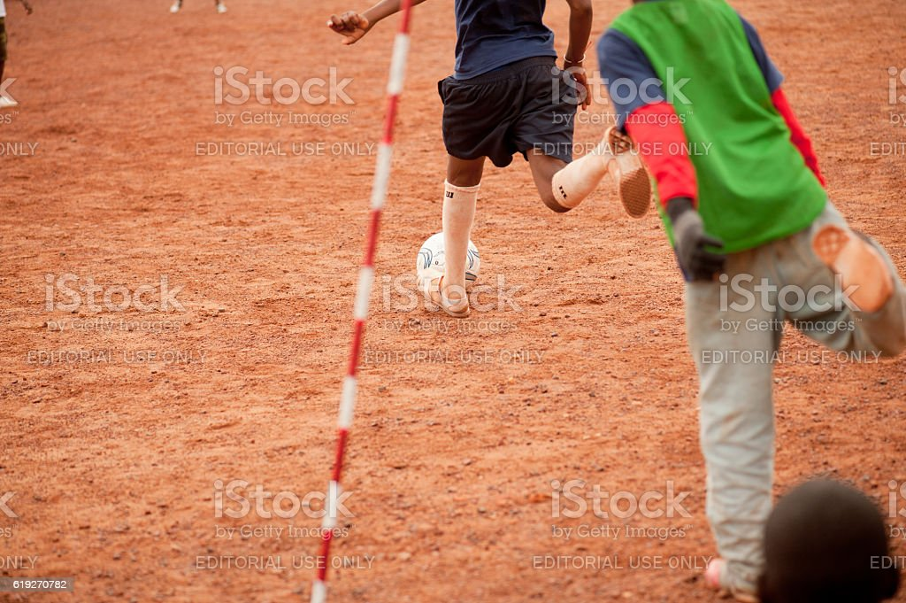 Black people playing soccer in a rural village stock photo
