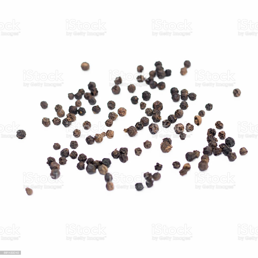 Black pepper on a white background stock photo