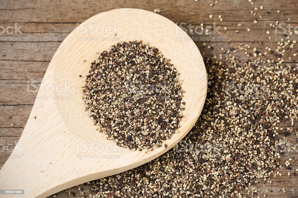 Black Pepper on Wooden Spoon stock photo