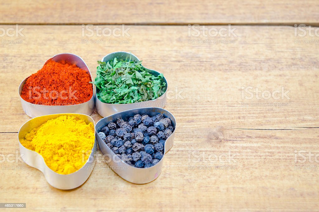 Black pepper, paprika, curry and basil royalty-free stock photo