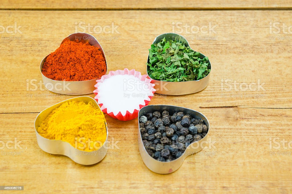 Black pepper, paprika, curry, basil and salt royalty-free stock photo