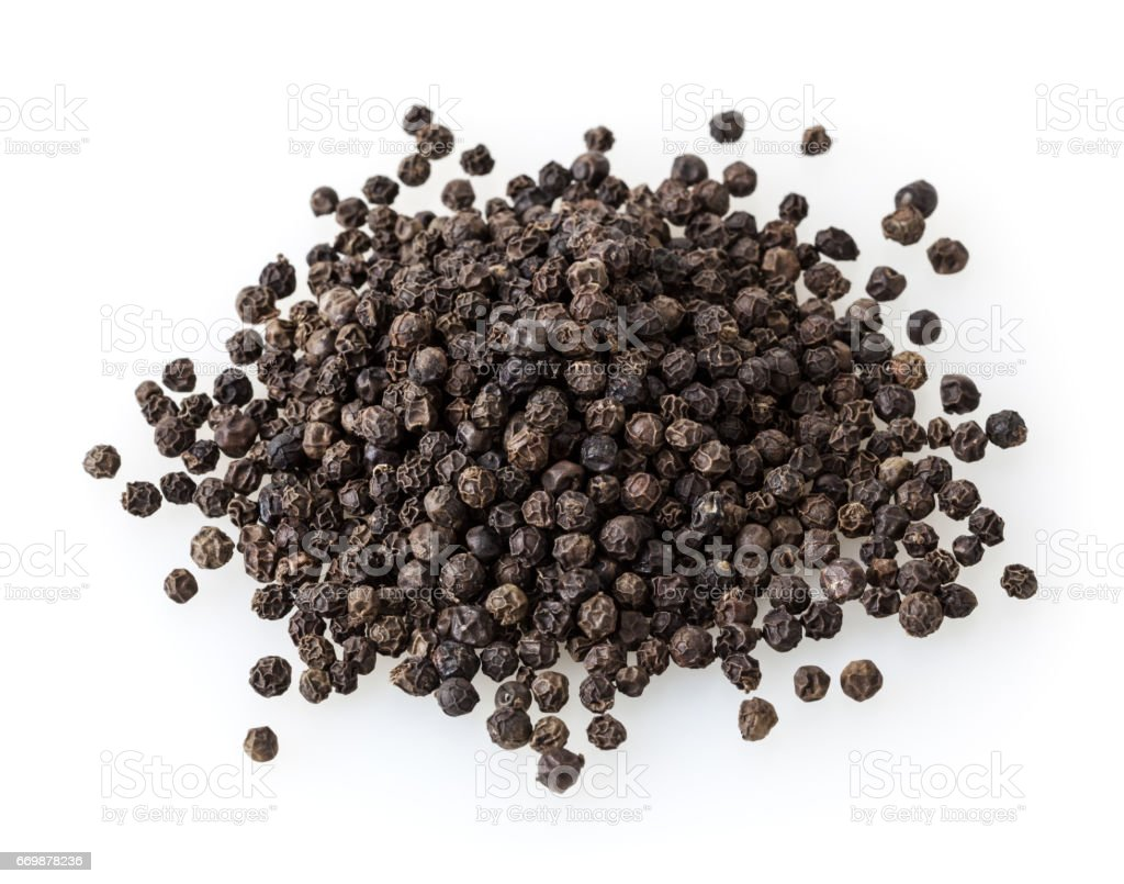 Black peppercorn isolated on white background stock photo