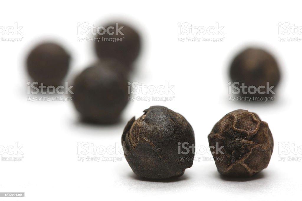 Black Peppercorns Isolated on White Background stock photo