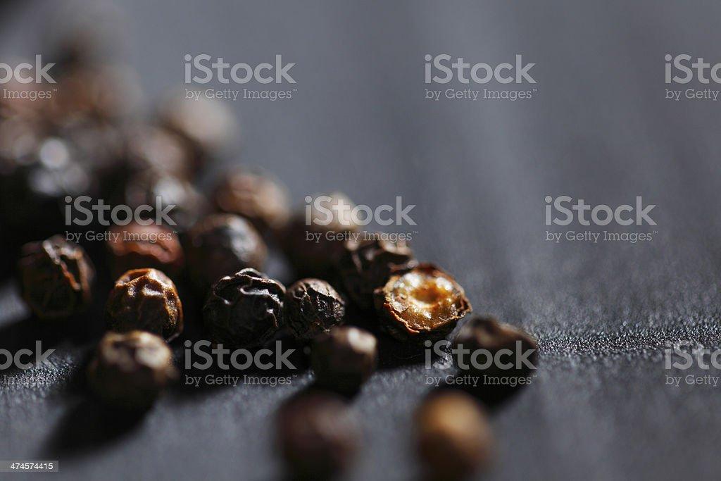 Black peppercorns stock photo