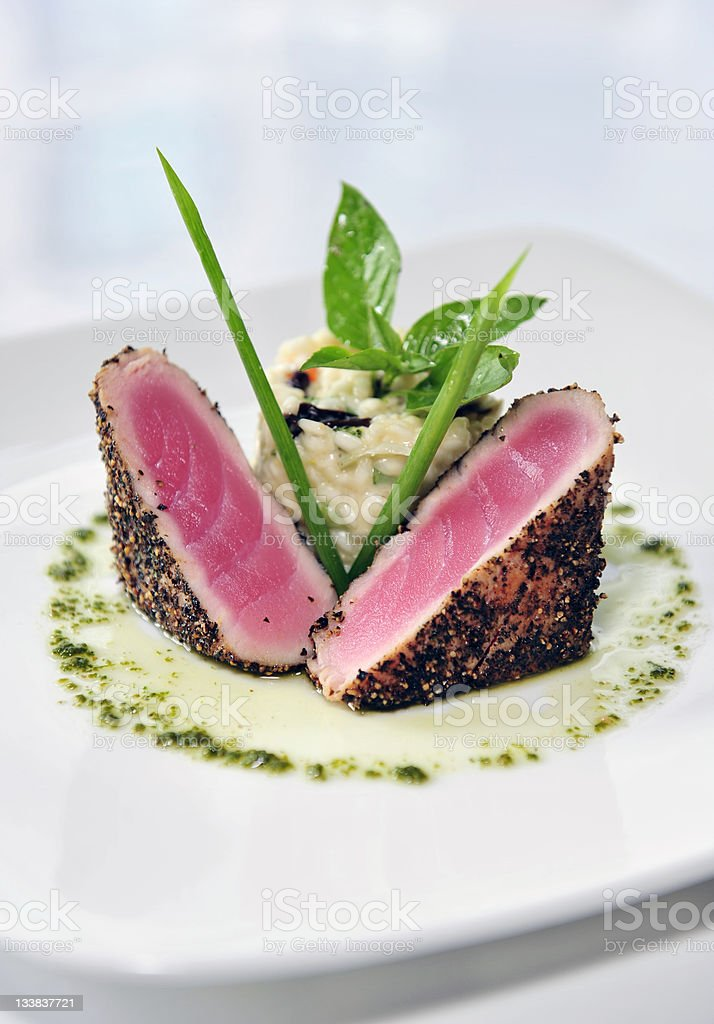 Black pepper-crusted Ahi tuna steak with risotto stock photo
