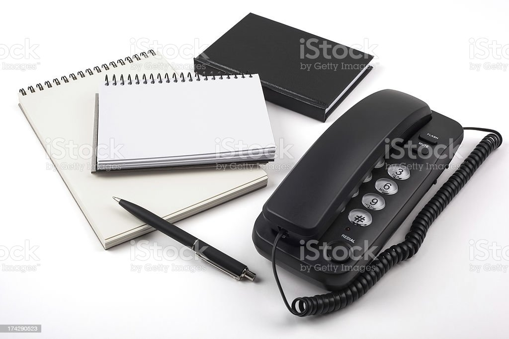 Black phone and notebooks on white background royalty-free stock photo