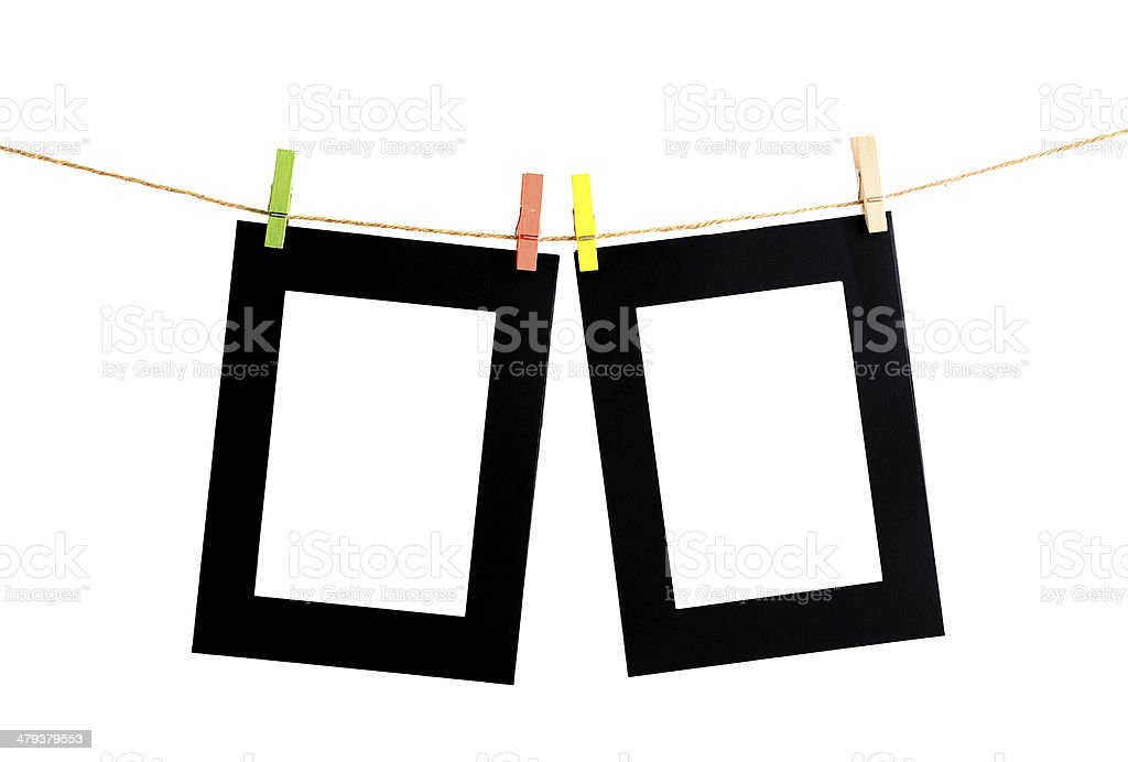 Black picture frame on clothesline with white background stock photo