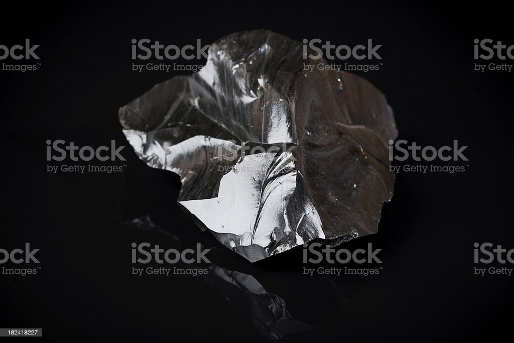 Black piece of Obsidian stock photo