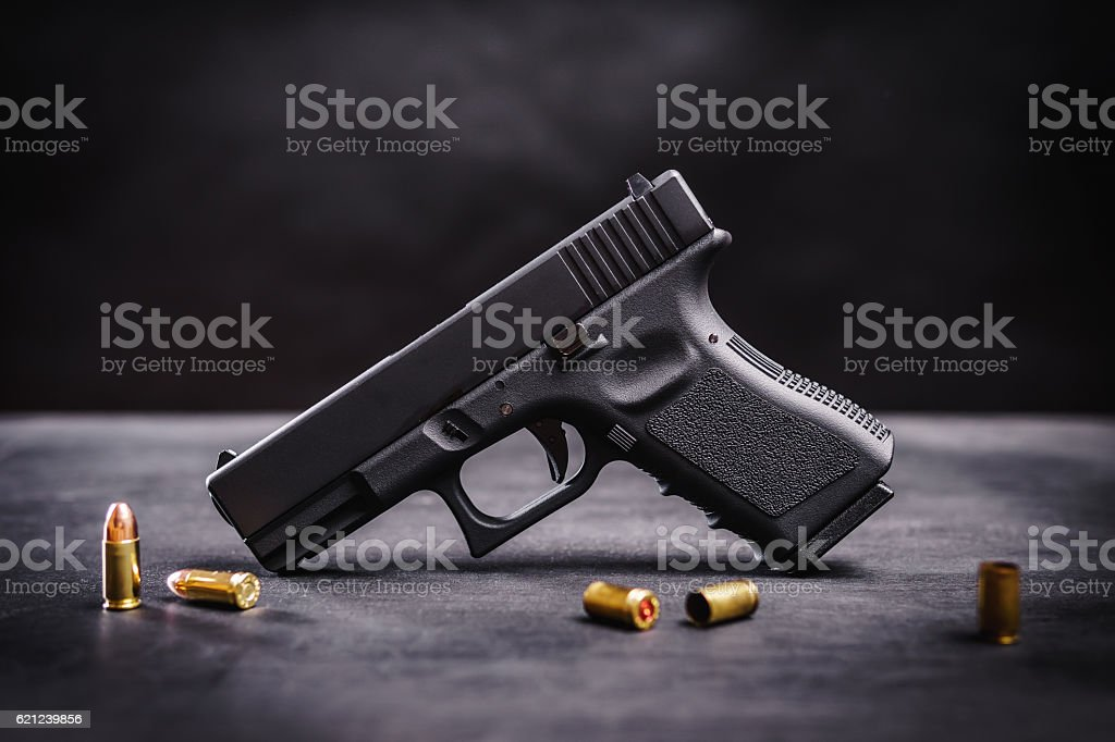 black pistol on a black table stock photo