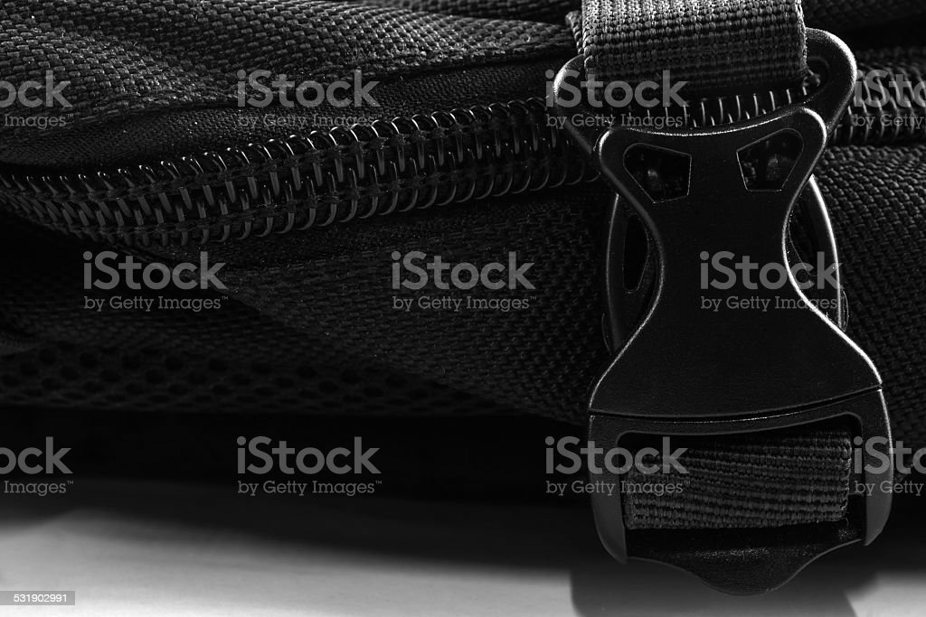 Black plastic buckle on backpack stock photo