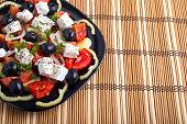 Black plate with Greek salad  closeup