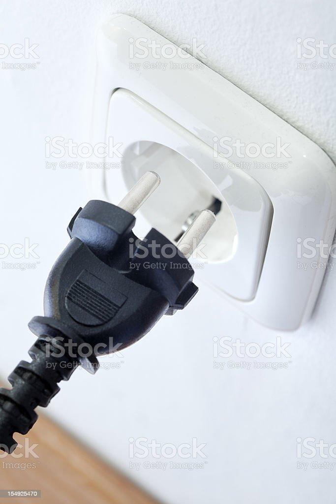 Black plug and white socket royalty-free stock photo