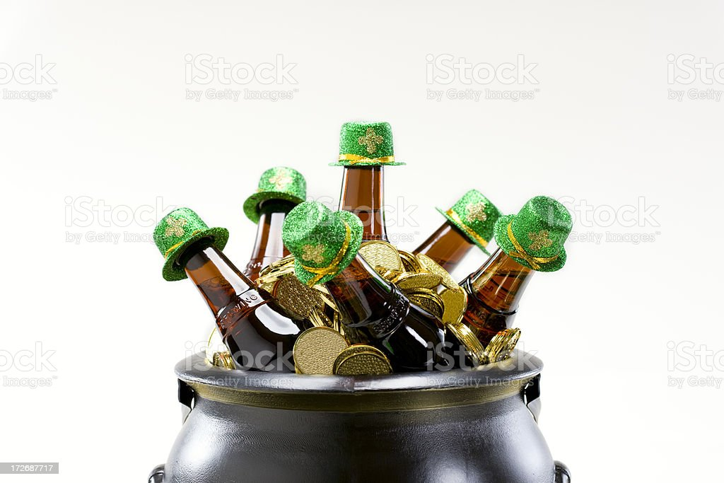 Black Pot of Gold with St Patricks Beer Bottles, Copyspace stock photo