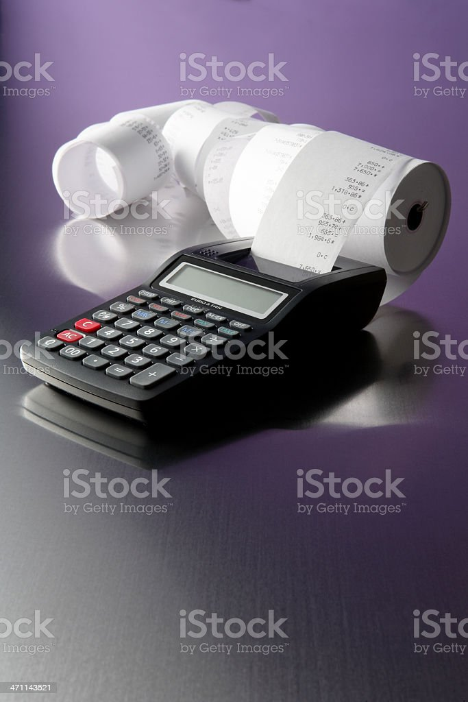 Black printing calculator with paper roll royalty-free stock photo