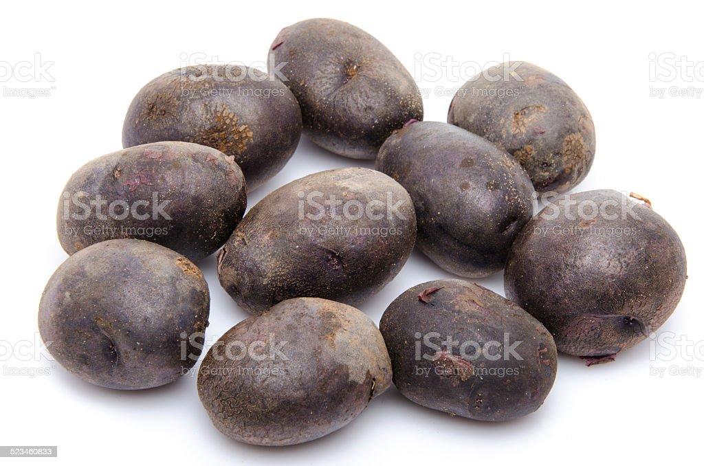 Black purple potatoes vitelotte stock photo