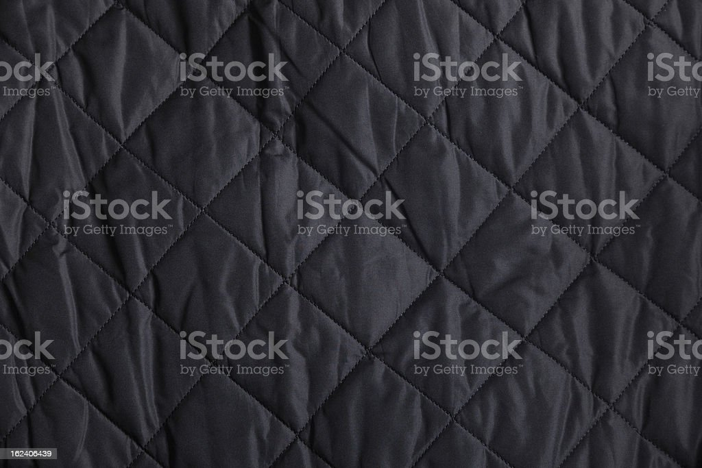 Black Quilted Fabric Background royalty-free stock photo