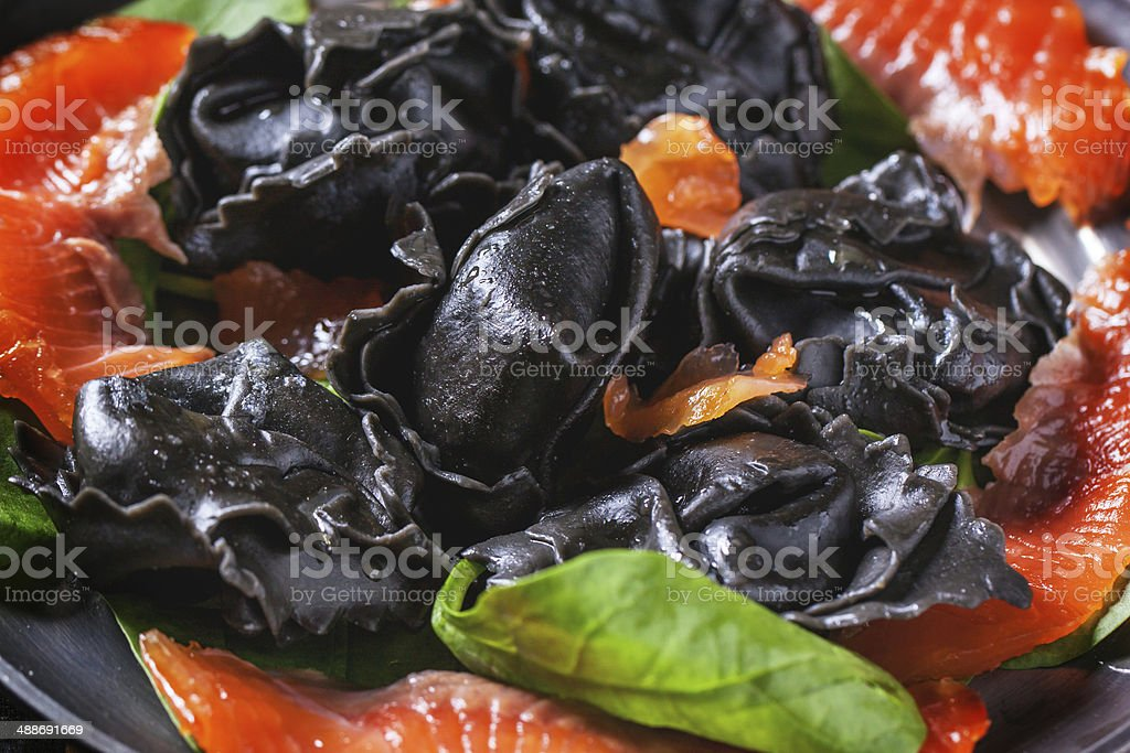 Black ravioli with salted salmon royalty-free stock photo