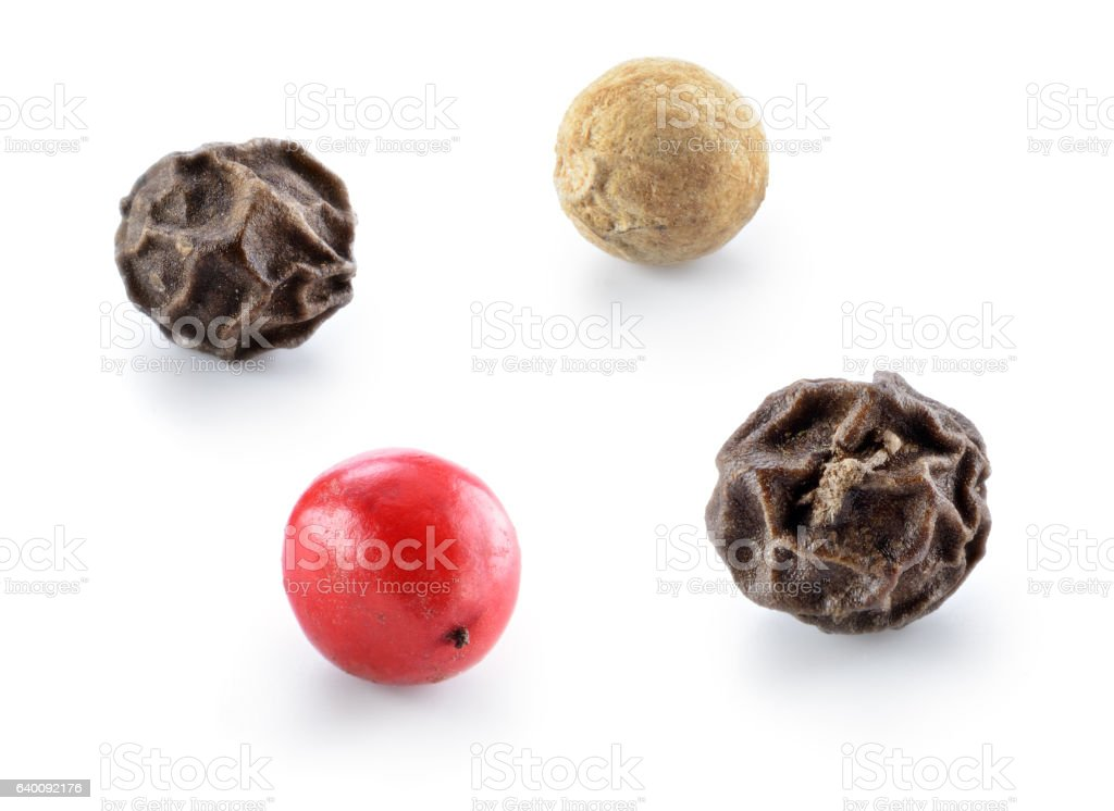 Black, red and white pepper isolated. stock photo