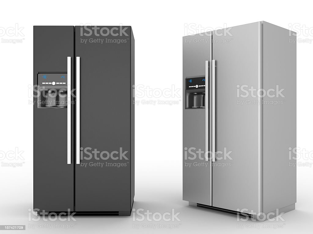 A black refrigerator and a silver refrigerator stock photo