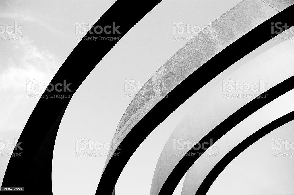 Black repeating architectural details in the form of arches stock photo