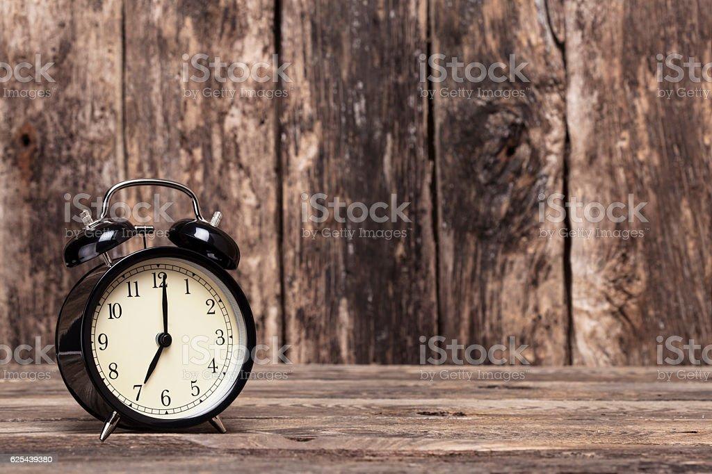 Black retro clock showing 07:00 am or pm stock photo