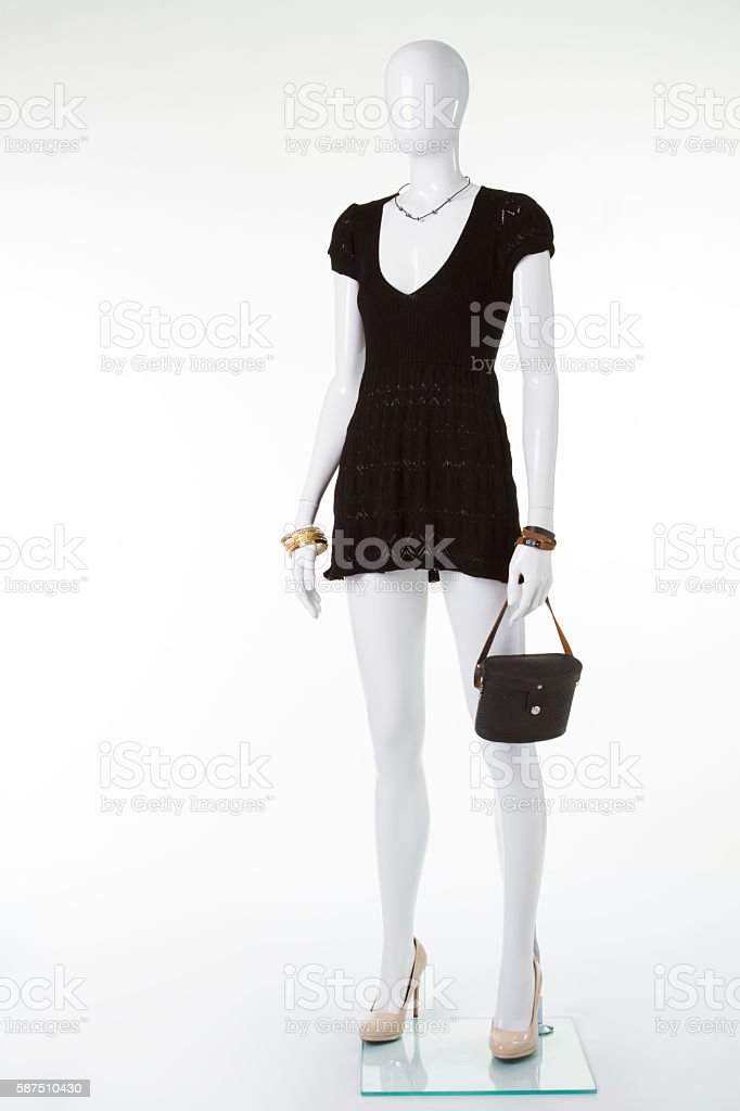 Black retro handbag on mannequin. stock photo