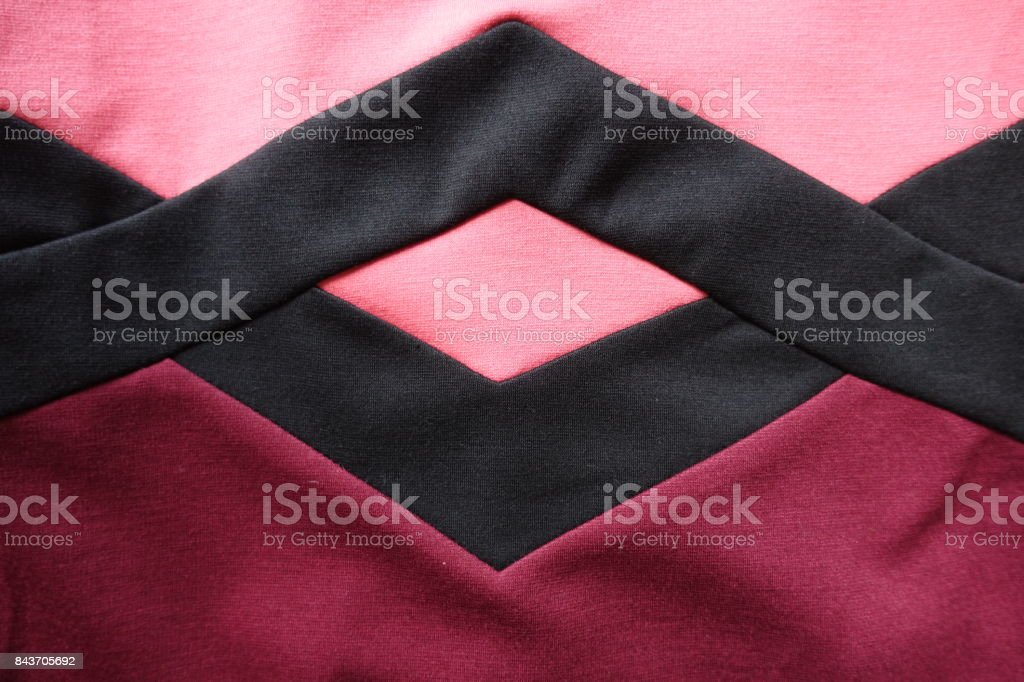 Black rhomb stotched to pink and red stockinet stock photo