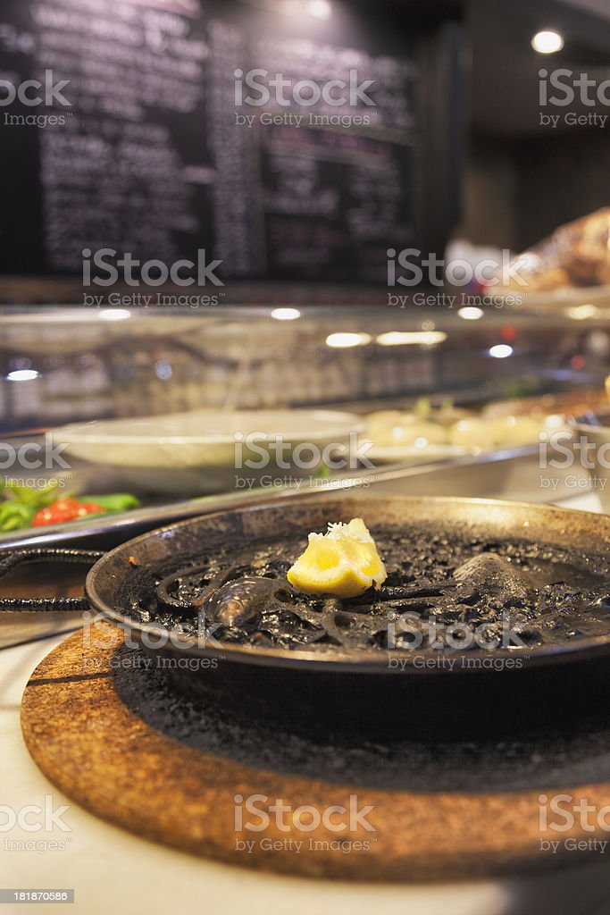 Black Rice Paella in a Spanish Tapas Bar stock photo