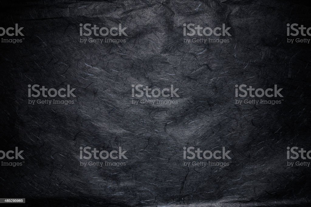 Black rice paper texture background with spotlight royalty-free stock photo
