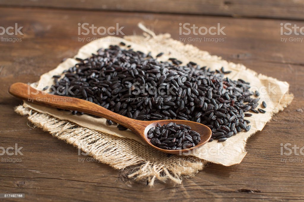Black rice with a spoon stock photo