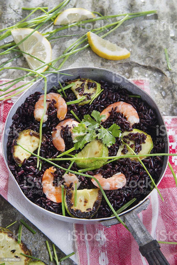 Black rice with shrimp and zucchini stock photo