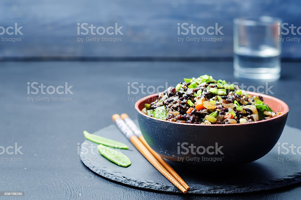 Black rice with snap peas and vegetables stock photo