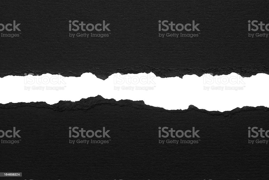 Black ripped paper stock photo