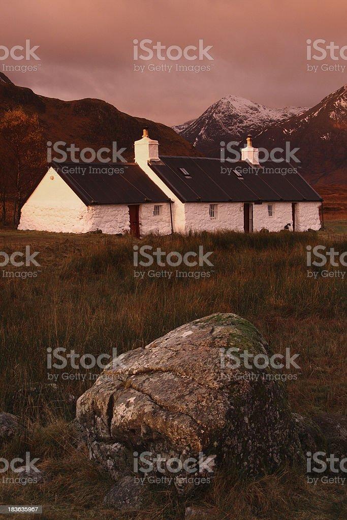 Black Rock cottage, Rannoch Moor, Scottish Highlands at sunrise. royalty-free stock photo
