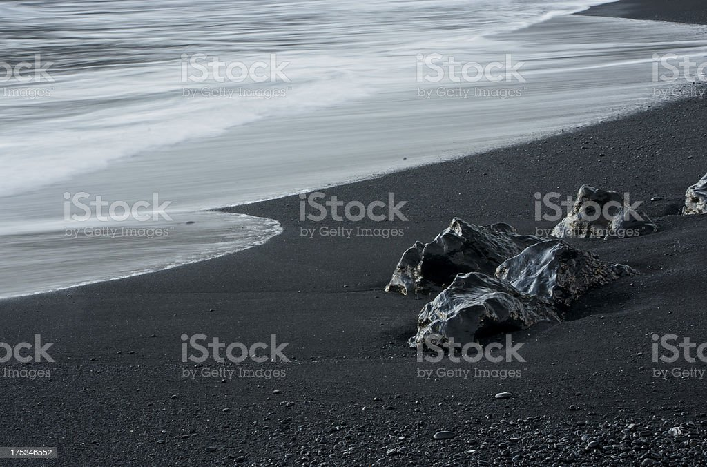 Black Rocks Meet the Ocean royalty-free stock photo