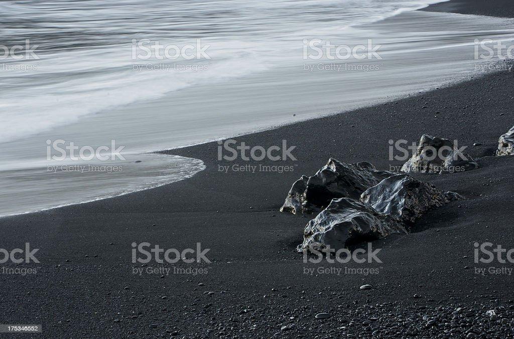 Black Rocks Meet the Ocean stock photo