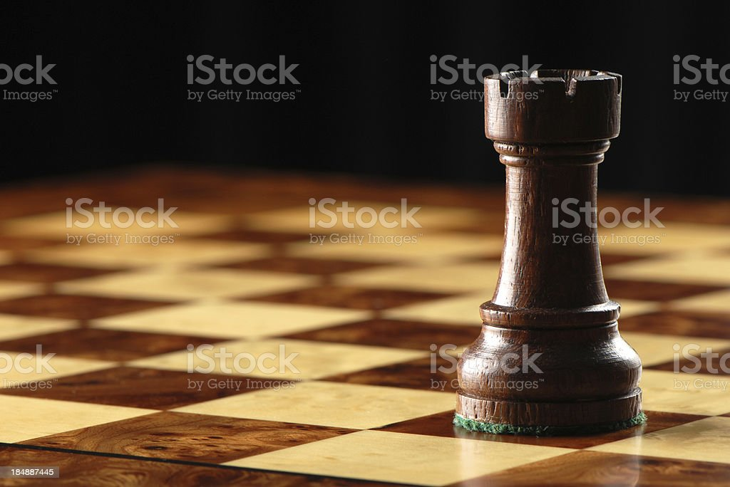 Black Rook on Chessboard stock photo