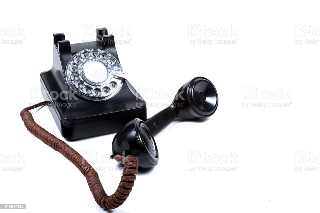 Black Rotary Phone With The Reciver Off The Hook stock photo