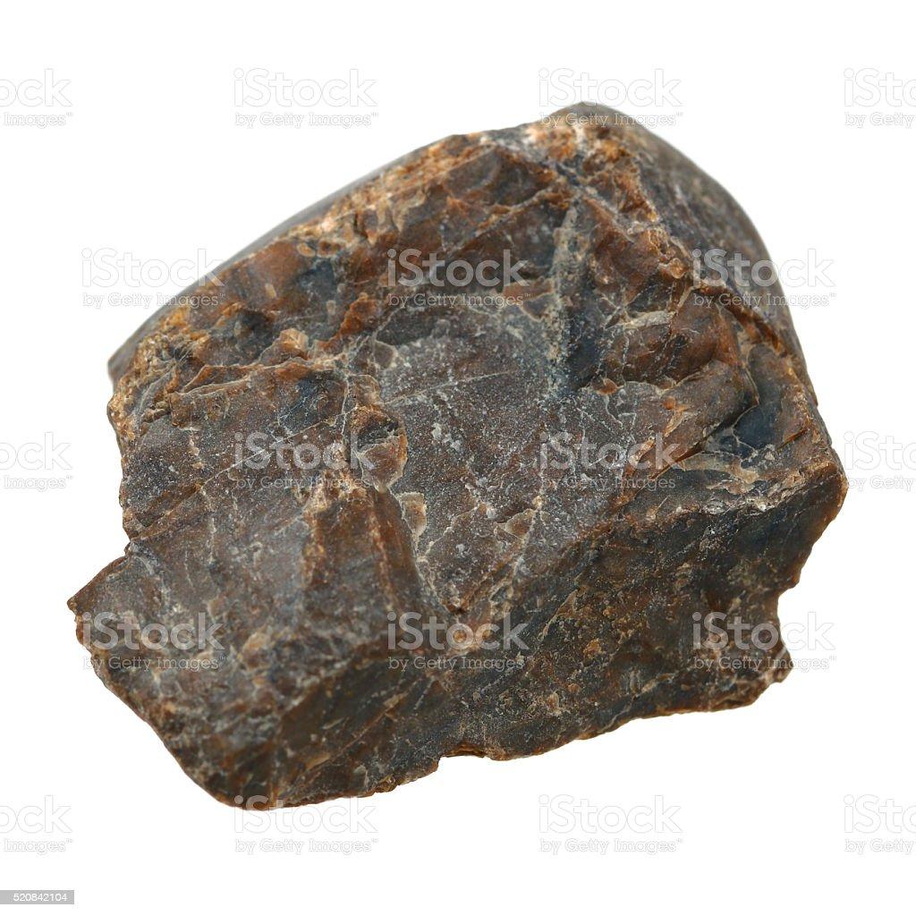 Black rough stone isolated on white stock photo