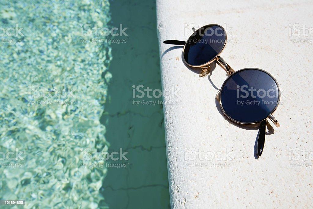 black round sun glasses on pool board royalty-free stock photo