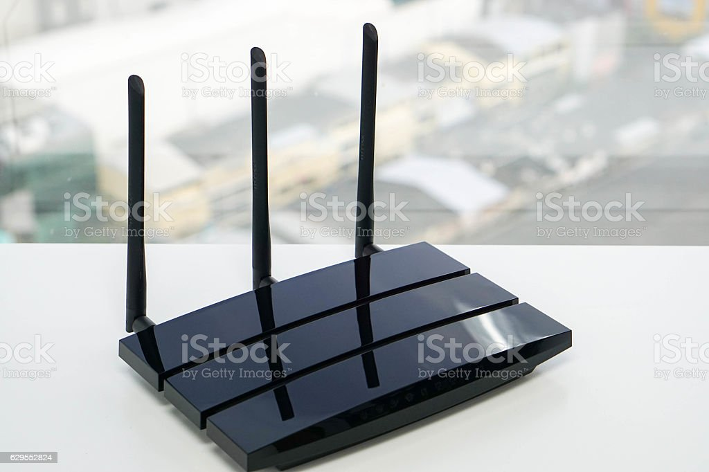 black router in office with city backdrop stock photo