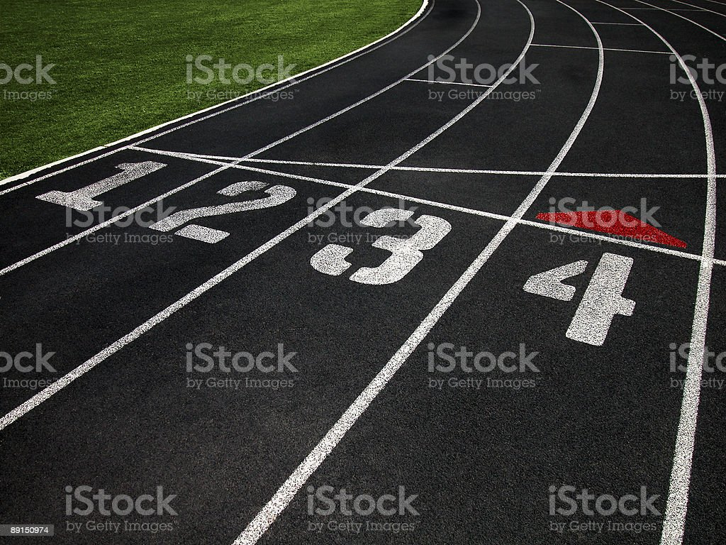 Black Running Track with Four Lanes royalty-free stock photo