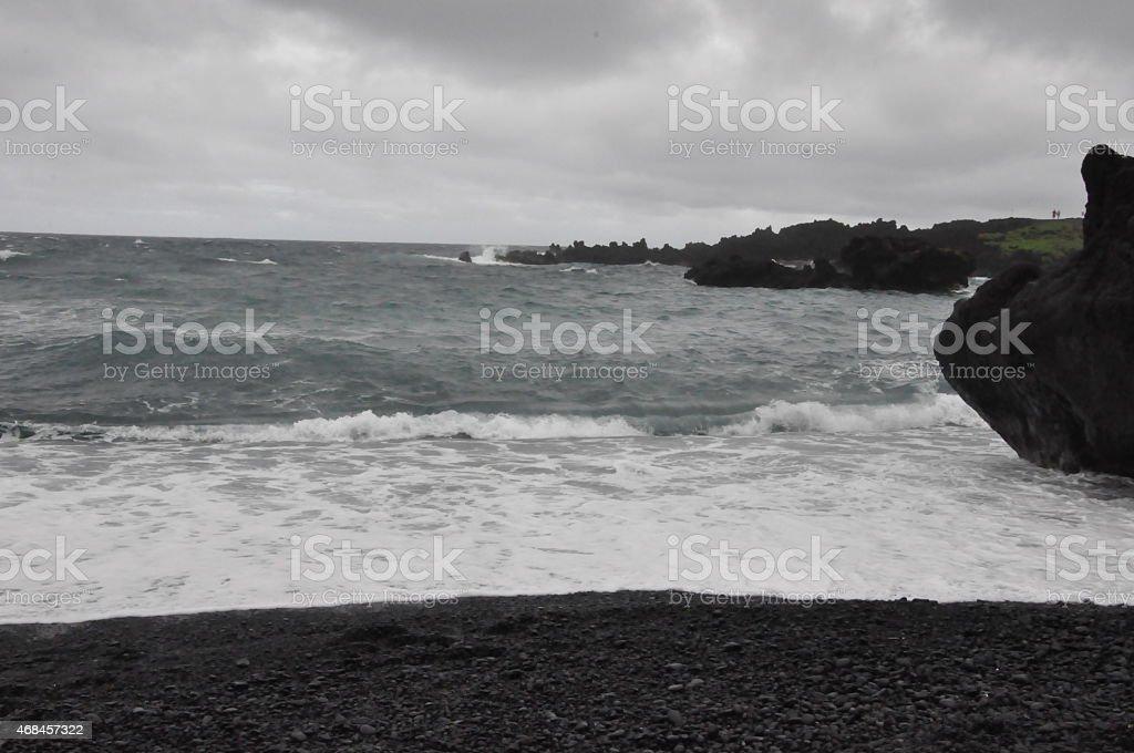Black Sand Beach at Waianapanapa State Park in Maui, Hawaii stock photo