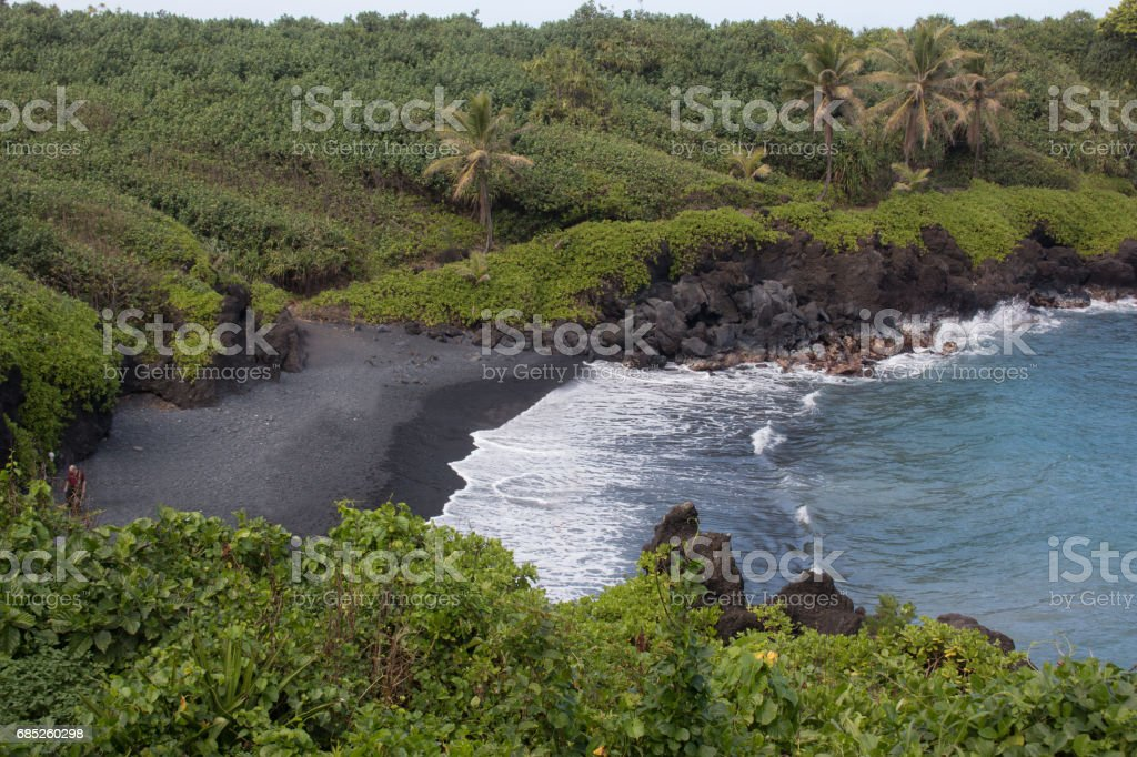 Black Sand Beach in Hana, Maui stock photo