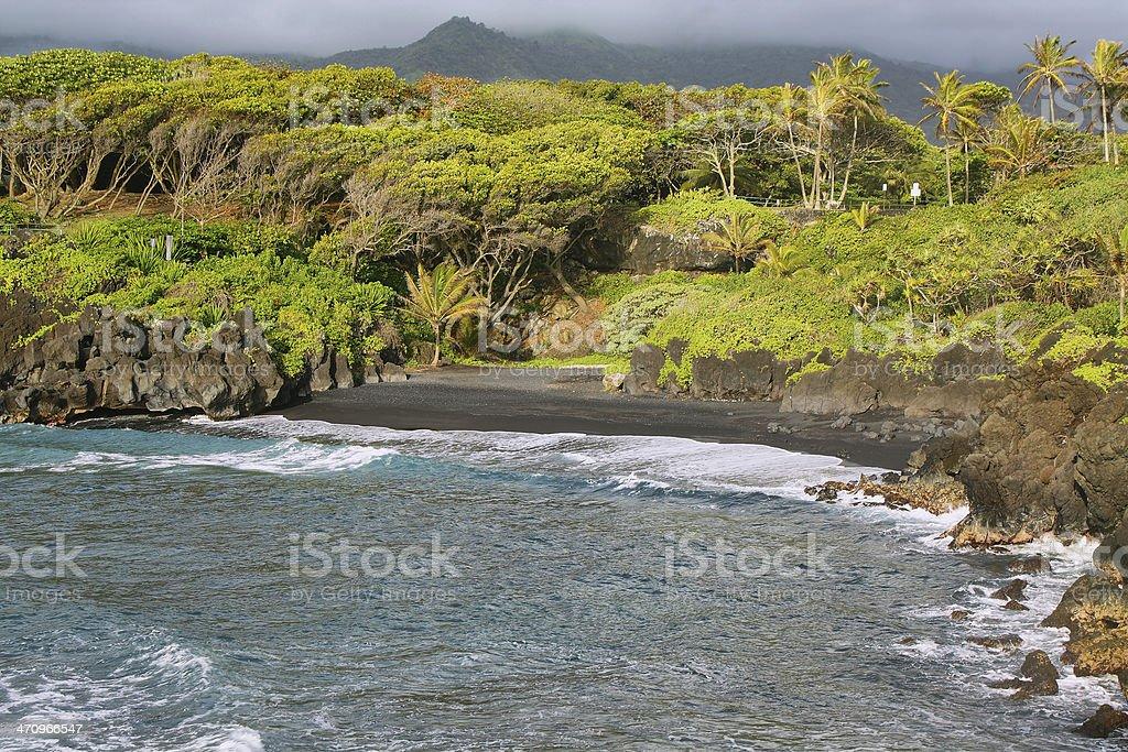 Black sand beach views in Waianapanapa State park stock photo