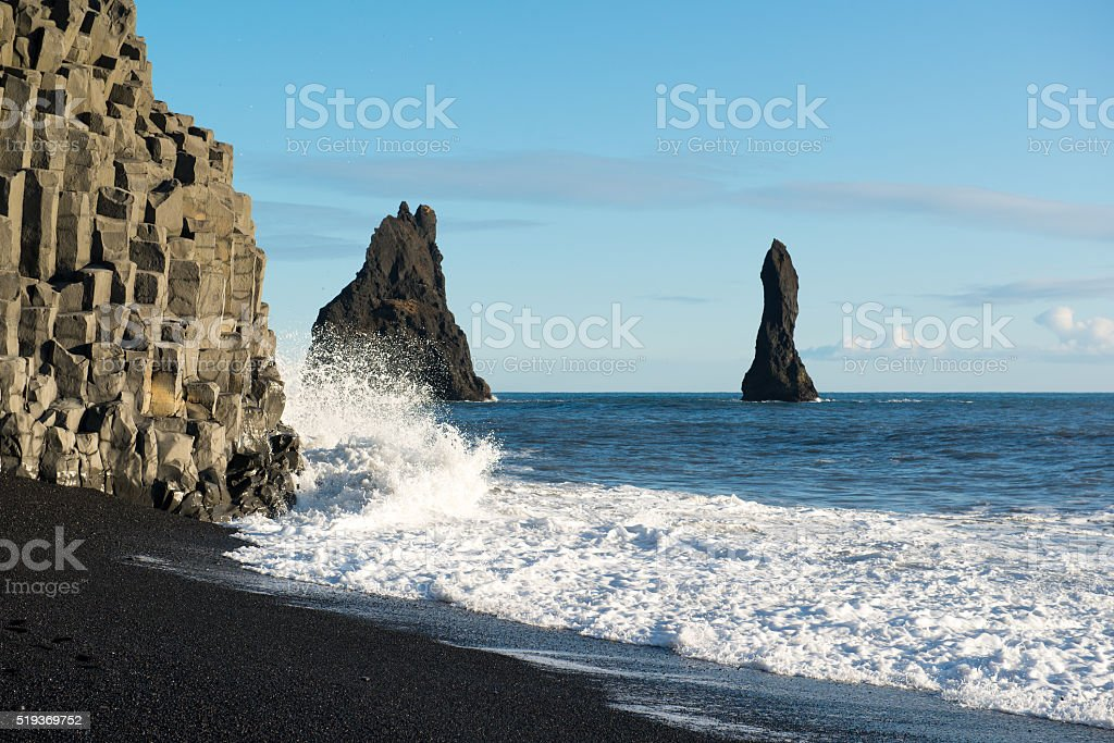 Black sand beach with ocean, Reynisdrangar rocks at winter, Iceland stock photo