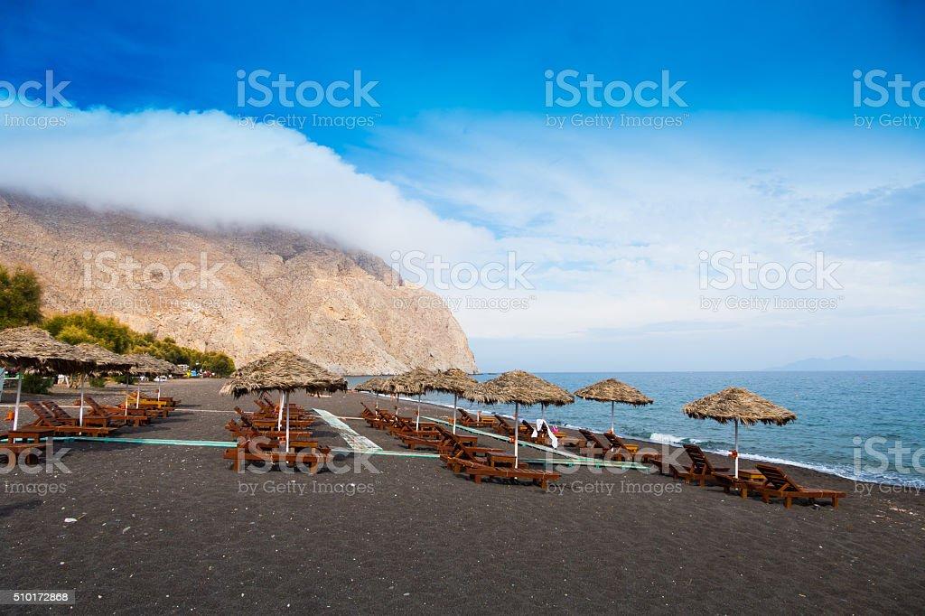 Black sand Santorini beach, Greece stock photo