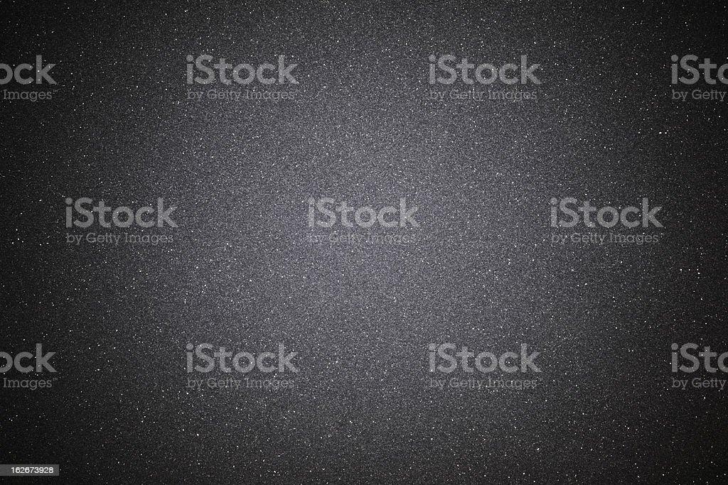 Black sand texture background with spotlight stock photo