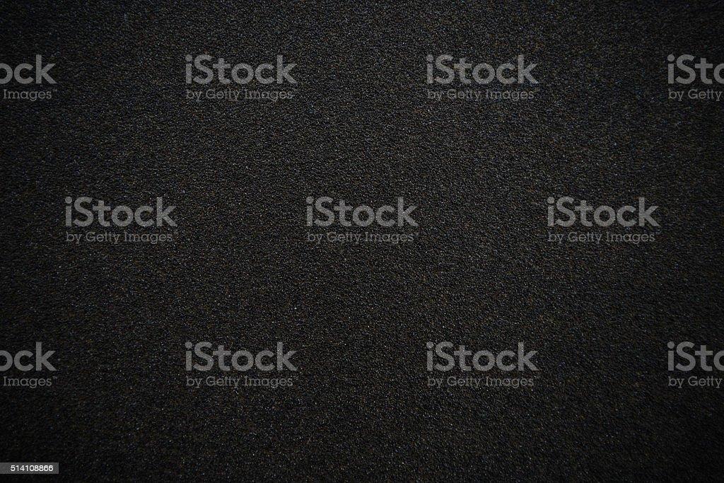Black sandpaper texture background stock photo