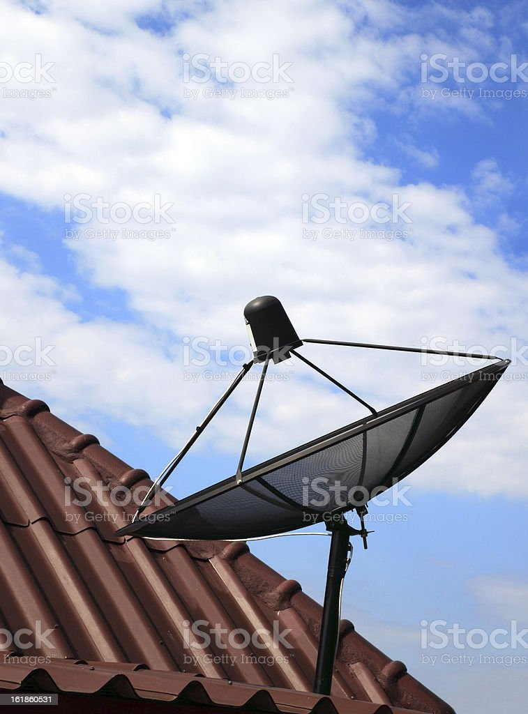 black satellite dish on house roof royalty-free stock photo
